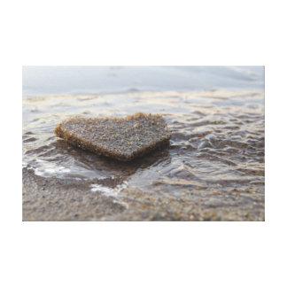 Frozen concrete heart on beach canvas print