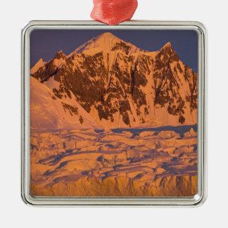 frozen glacial mountain landscape along the christmas ornament