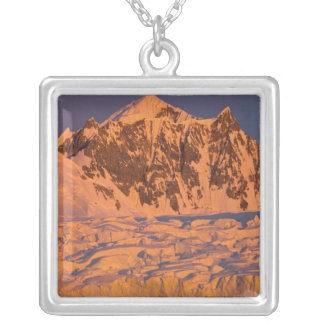 frozen glacial mountain landscape along the silver plated necklace