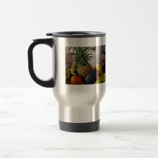 Fruit bowl with avocado foremost coffee mugs