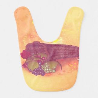 Fruit, cornucopia with grapes in vintage baby bibs