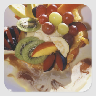 Fruit salad with ice cream. square sticker