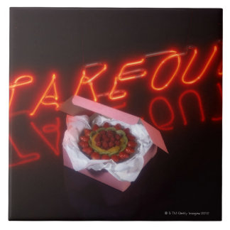 Fruit tart with neon take-out sign tile