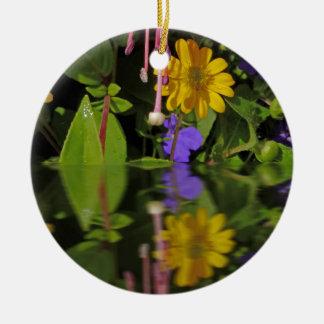 Fuchsia  flower in reflection round ceramic decoration