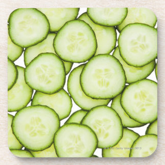 Full frame of sliced cucumber, on white coasters
