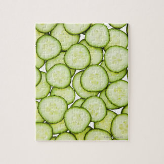 Full frame of sliced cucumber, on white jigsaw puzzle