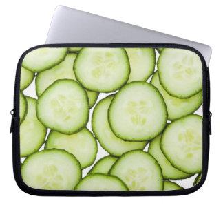 Full frame of sliced cucumber, on white laptop sleeve