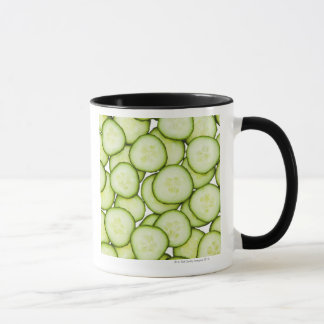 Full frame of sliced cucumber, on white mug