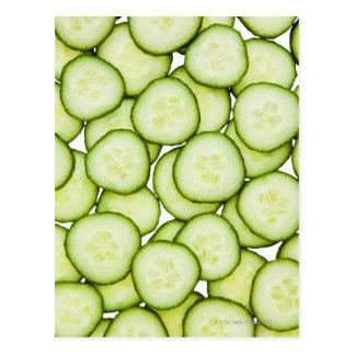 Full frame of sliced cucumber, on white postcard