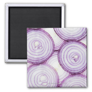 Full frame of sliced red onion, on white magnet