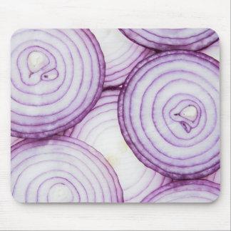 Full frame of sliced red onion, on white mouse mat