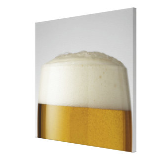 Full glass of beer indoors canvas prints
