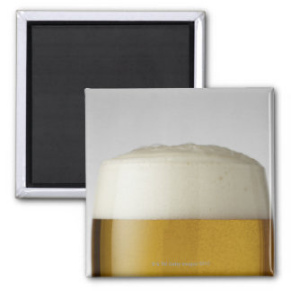 Full glass of beer indoors magnet