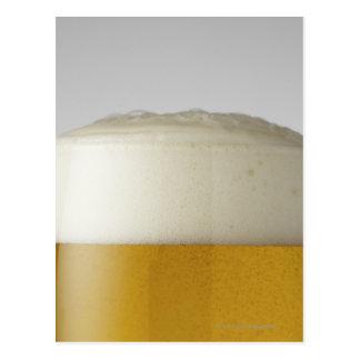Full glass of beer indoors postcard