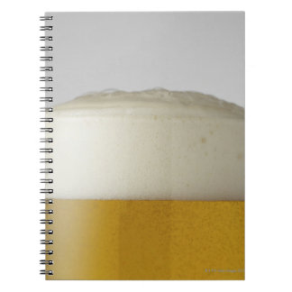 Full glass of beer indoors spiral notebook