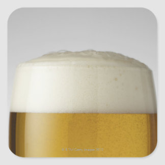 Full glass of beer indoors square sticker
