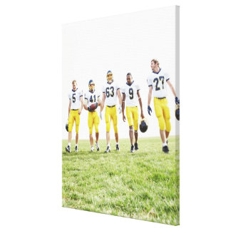 Full length portrait of rugby team canvas print