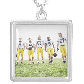 Full length portrait of rugby team silver plated necklace
