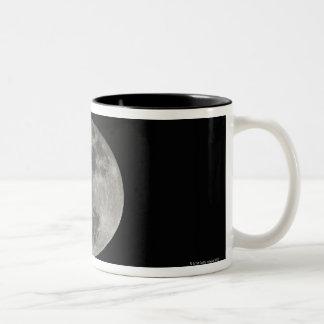 Full moon against night sky mug