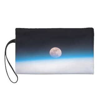 Full moon partially obscured by atmosphere wristlet clutch