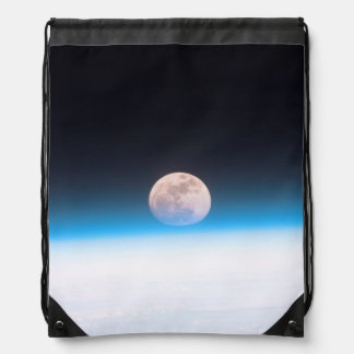 Full moon partially obscured by atmosphere drawstring backpacks