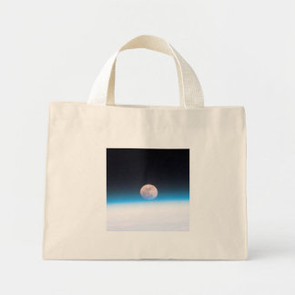 Full moon partially obscured by atmosphere mini tote bag