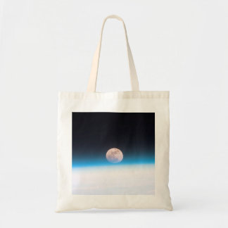 Full moon partially obscured by atmosphere budget tote bag