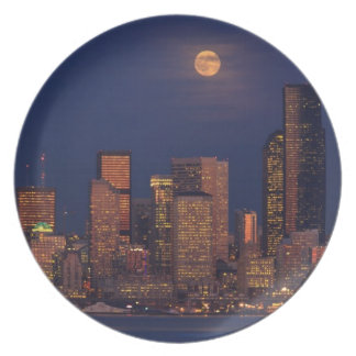 Full moon rising over downtown Seattle skyline Plate