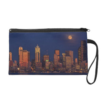 Full moon rising over downtown Seattle skyline Wristlet Clutches