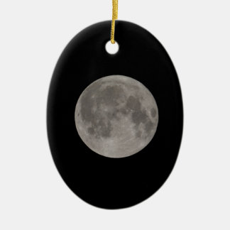 Full moon seen with a telescope at night ceramic oval decoration