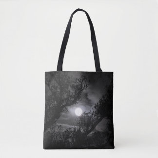 Full moon through the branches tote bag