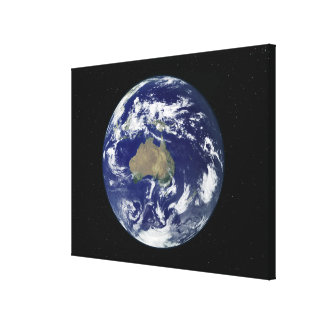 Fully lit Earth centered on Australia and Ocean Stretched Canvas Print