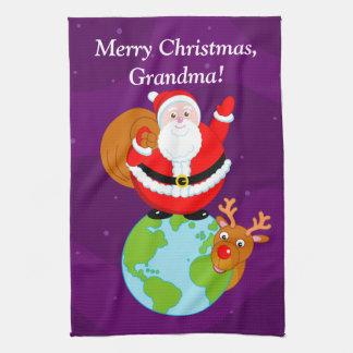 Fun cartoon of Santa Claus standing on the Earth, Tea Towel
