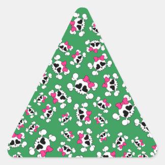 Fun green skulls and bows pattern triangle sticker