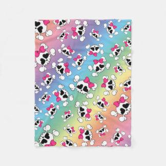 Fun rainbow skulls and bows fleece blanket