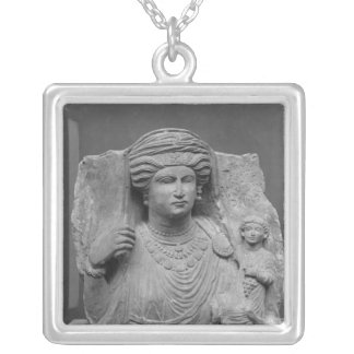 Funerary relief of mother and child from silver plated necklace