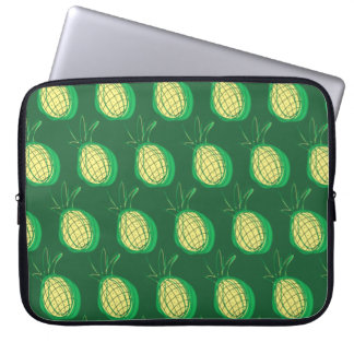 Funky pineapples on green background computer sleeves