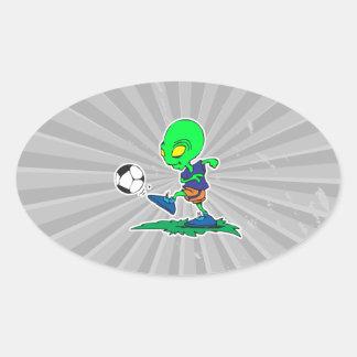 funny alien soccer player kicking ball oval sticker