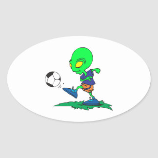 funny alien soccer player kicking ball oval sticker