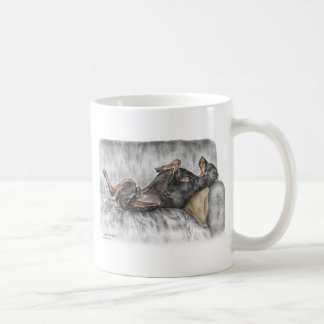 Funny Doberman on Sofa Coffee Mug