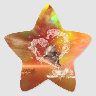 Funny dolphin jumping by a heart star sticker