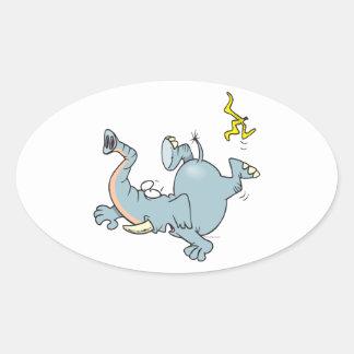 funny elephant slipping on banana peel oval sticker