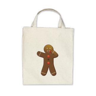 Funny Gingerbreadman eating himself Bags