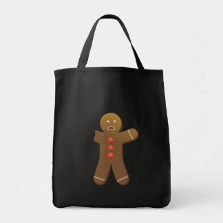 Funny Gingerbreadman with half eaten arm Tote Bags