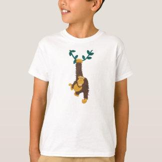 Funny grinning Gorilla swinging on vine T-Shirt