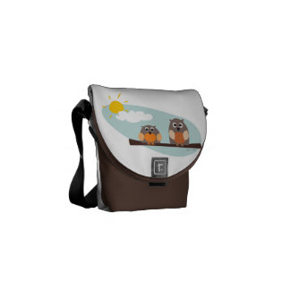 Funny owls on branch on sunny day Messenger Bag