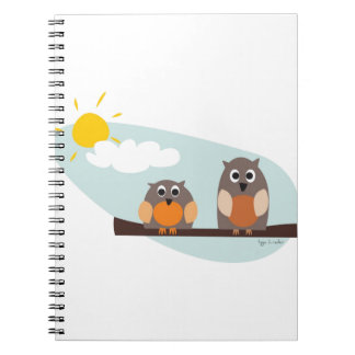 Funny owls on branch on sunny day spiral note books