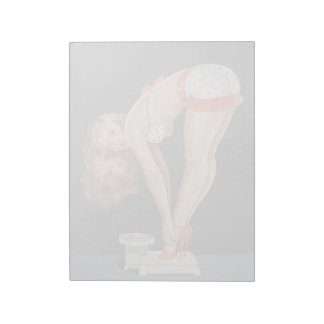 Funny retro pinup girl on a weight scale notepad