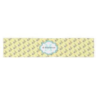 Funny stethoscopes for doctors on yellow name short table runner