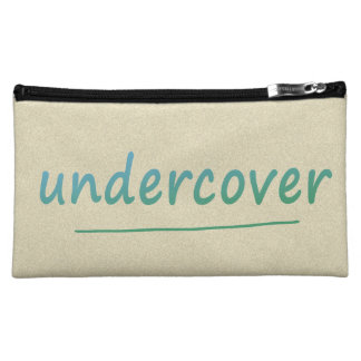 Funny Undercover Shiny Turqoise Text on any Color Cosmetic Bags
